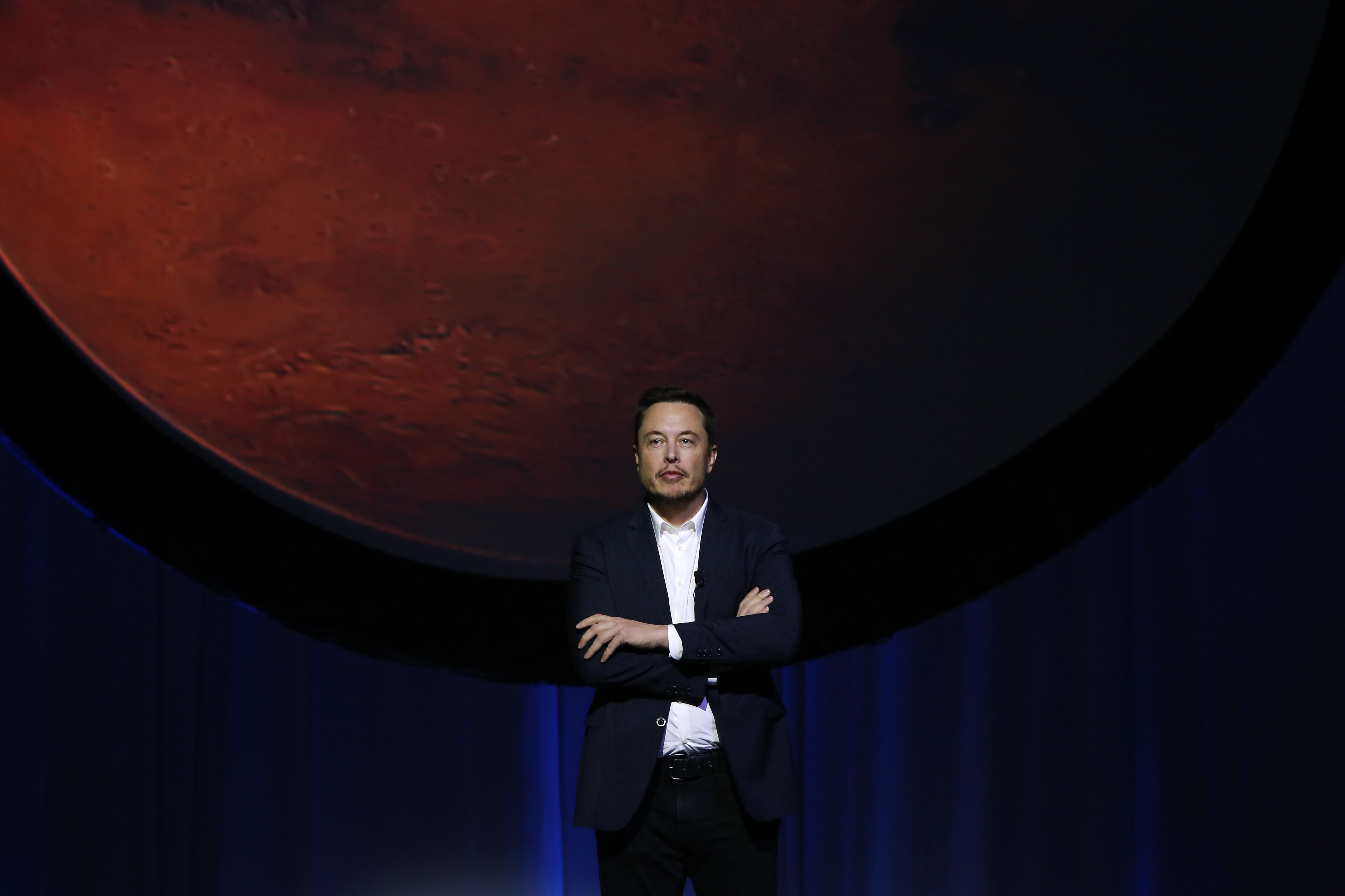 """Elon Musk, chief executive officer for Space Exploration Technologies Corp. (SpaceX), pauses during the 67th International Astronautical Congress (IAC) in Guadalajara, Mexico, on Tuesday, Sept. 27, 2016. Musk delivered a keynote address at the conference titled """"Making Humans a Multiplanetary Species"""" and tackled the technical challenges and """"potential architectures for colonizing the Red Planet."""" Photographer: Susana Gonzalez/Bloomberg via Getty Images"""